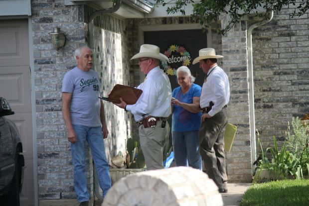 Denton County Sheriff's Deps talk to neighbors May 16, 2018, after man shot and killed his ex-wife's boyfriend and three children then himself..jpg