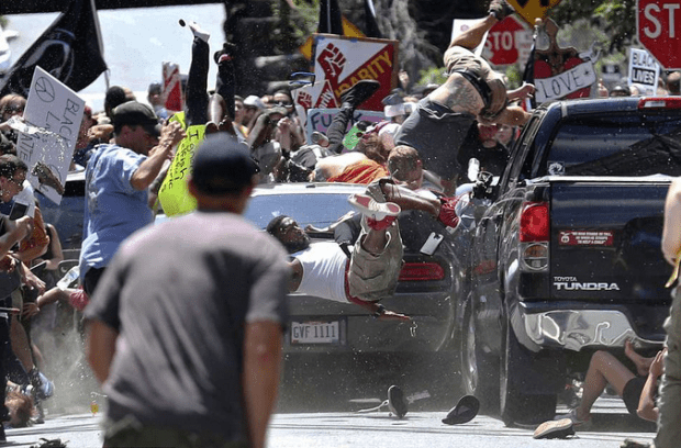 Marcus Martin is airborne after being hit by White Nationalist driver in Charlottesville.png