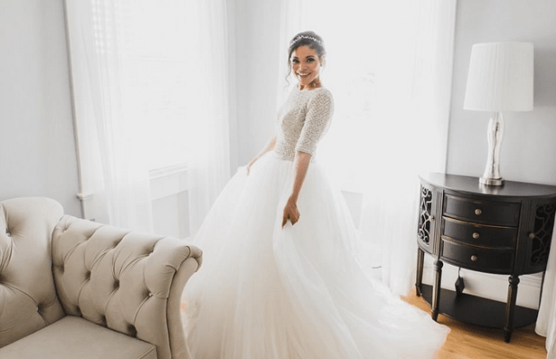 Marissa Blair strikes pose in her wedding dress 1.png