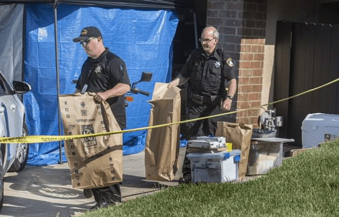 Police take bags of evidence from the James DeAngelo's home 1