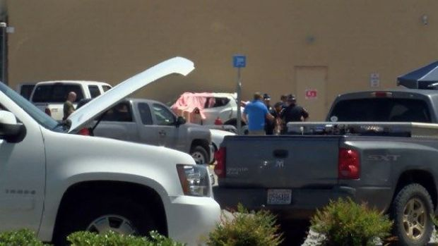 Victims of Alabama Walmart shooting are covered with pink tarp.JPG