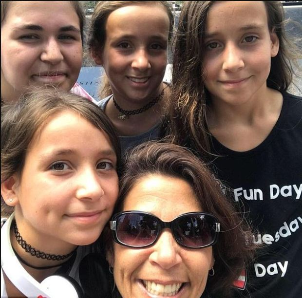 Charlene Orsi (front), her 12-year-old triplet daughters, and her 13-year-old daughter [top left]1.JPG