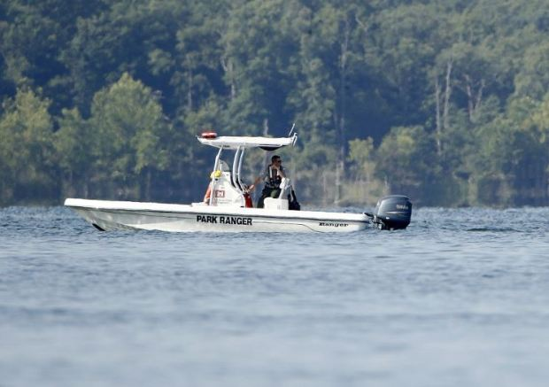 Park ranger searches the lake on Friday morning.JPG