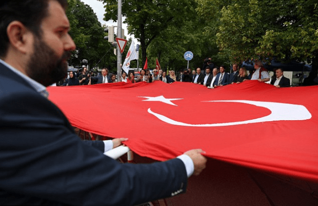 Turkish protesters in Munich, Germany unfurl their national flag outside the courthouse after Beate Zschaepe was jailed for life without parole.png