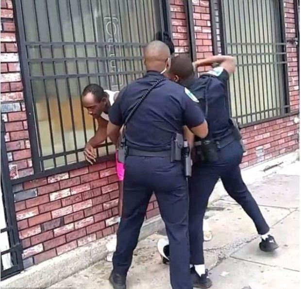 Baltimore cops filmed repeatedly punching man on the street 1.JPG