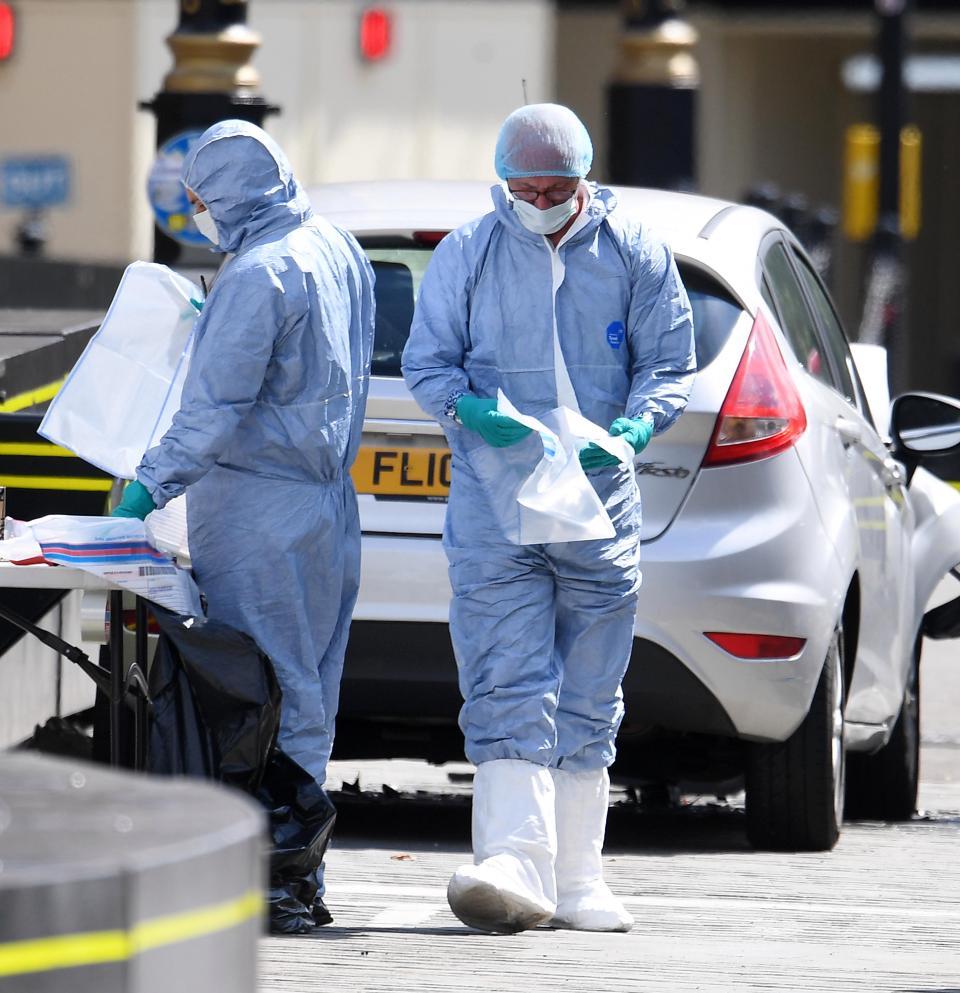 Police forensics team examine  the crash car1.jpg