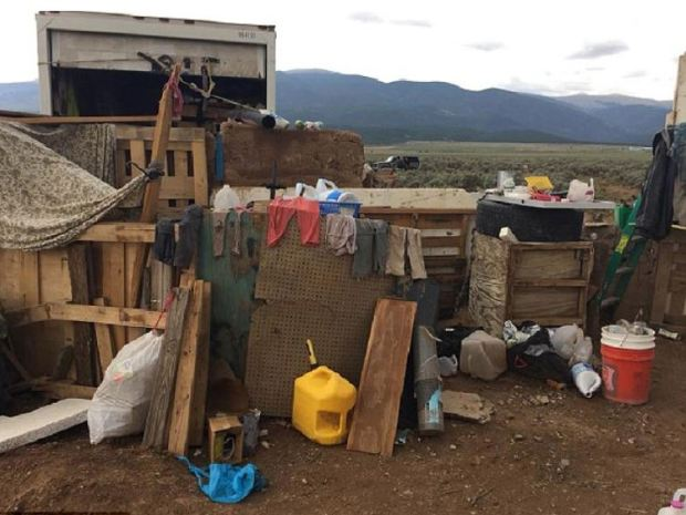 The squalid conditions inside the New Mexico trailer park compound were 11 children were rescued Fridays.JPG