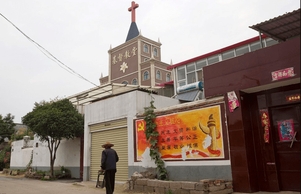 government billboard citing core values of the Communist Party next to a church in Pingdingshan 1