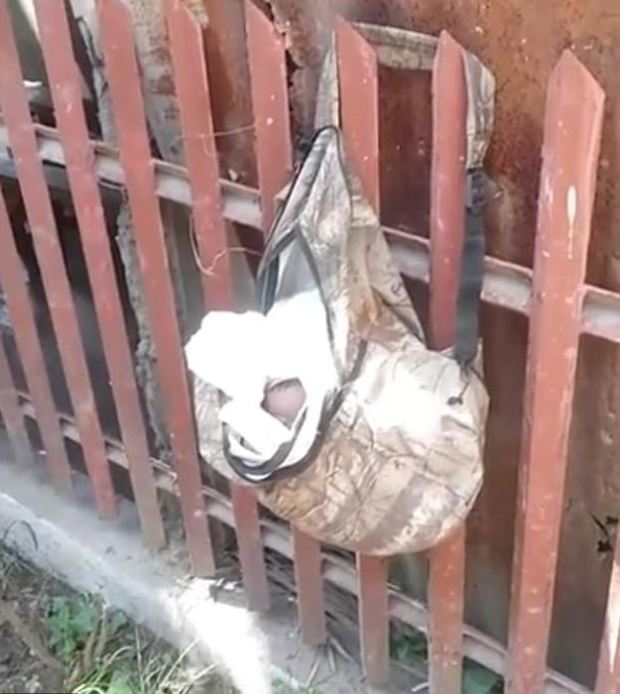 Baby found hanging in a thrash bag 1