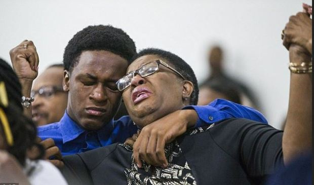 Botham Jean's 15-year-old brother Grant and mother Allison (center) at a prayer service at the Dallas West Church of Christ 2