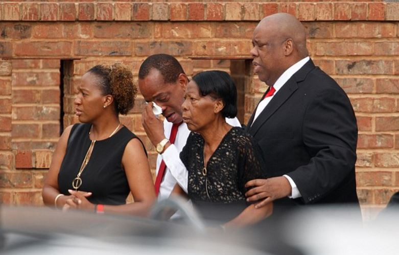 Botham Jean's famiy weep during a funeral service in Dallas, Texas on Sep13