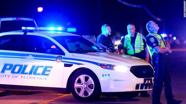 Police rediect traffic at scene of shooting that killed Terrence Carraway.jpg
