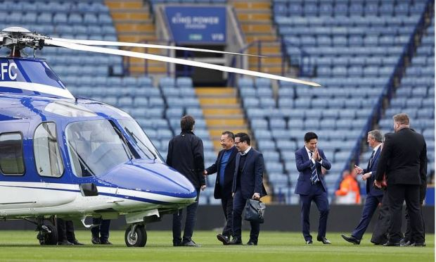Vichai Srivaddhanaprabha walks to his helicopter after a game.JPG