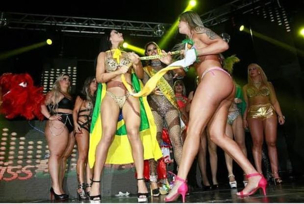 Ellen Santana, [left], tries clinging to her winner's sash as Aline Uva, [right] tries to grab it 3