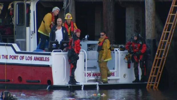 Rescuers pull two boys from a submerged vehicle in LA on April 9, 2015.JPG