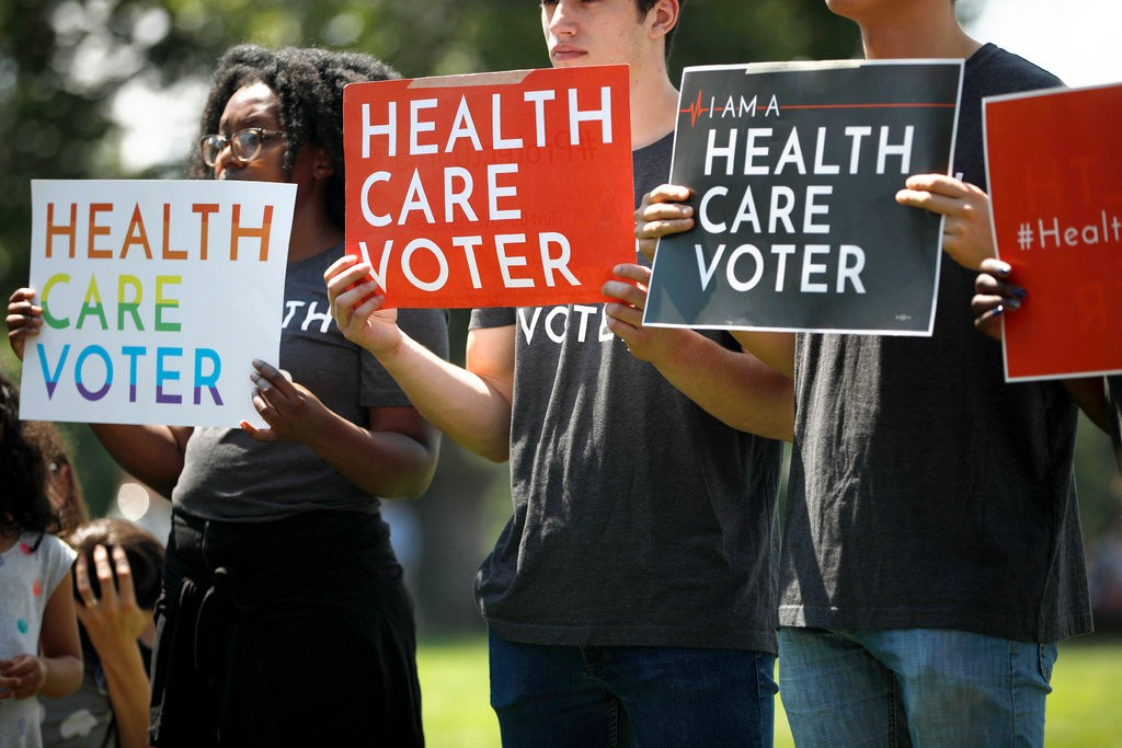 Demonstrators protesting changes to the Affordable Care Act in June 2018