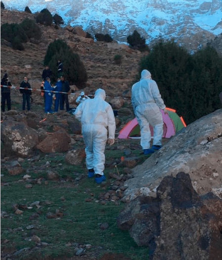 Morrocan police forensic team investigate the area where the bodies of two Scandinavian women tourists were found dead