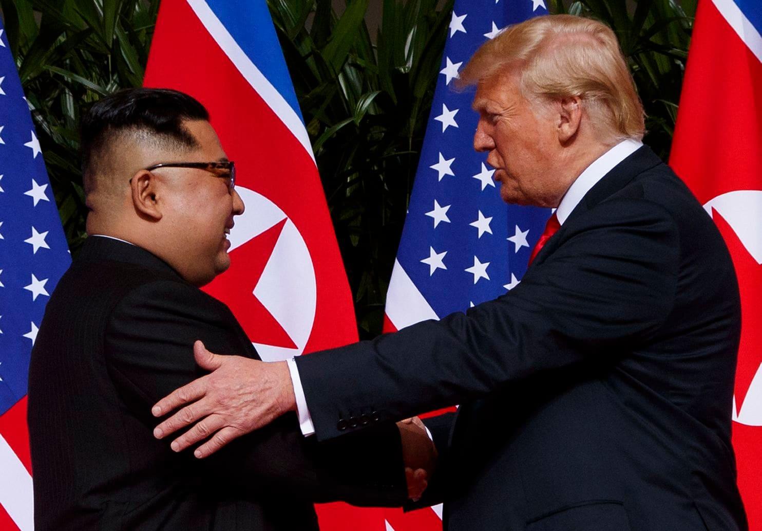 Donald Trump [right] and North Korean leader Kim Jong Un 1