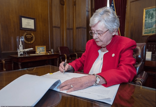 Alabama governor signs bill authorizing near total ban on abortion