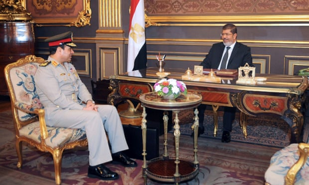 Morsi, right, and Abdel-Fatah al-Sisi at the presidential palace in Cairo 1