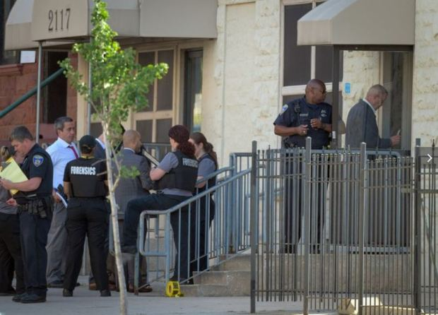 Baltimore Police investigate the scene of a shooting at the Man Alive drug treatment center