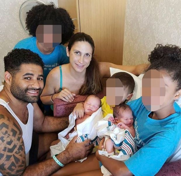 Juan Rodriguez with his wife, and their twins Mariza and Phoenix and other members of the family 3.JPG