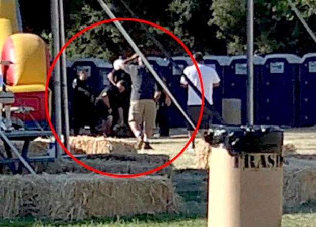 Video shows cops surrounding the suspect after they took him down.JPG