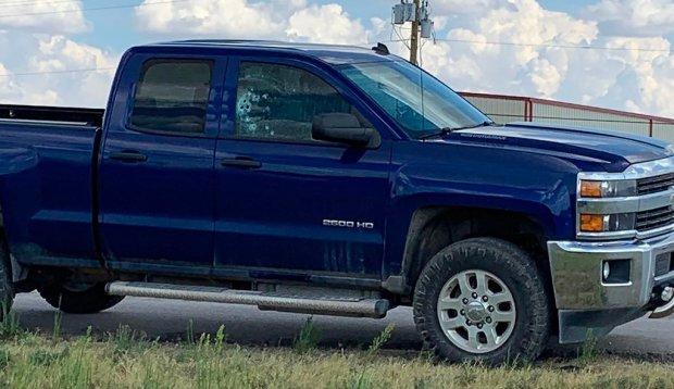 Bullet riddled pickup truck on Interstate 20 outside Odessa, Tex., on Aug 31, 2019.jpg
