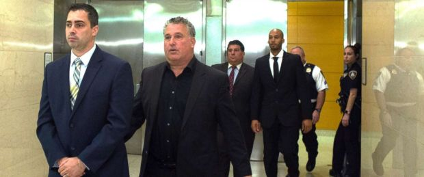 Edward Martins, left, and Richard Hall, right, are escorted out of Kings County Supreme Court in Brooklyn, Oct. 2017.