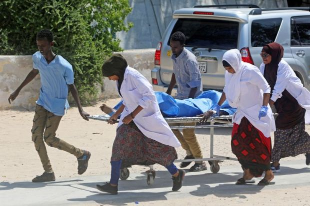 Nurses at the Medina hospital assist a civilian wounded in an explosion in Mogadishu.jpg
