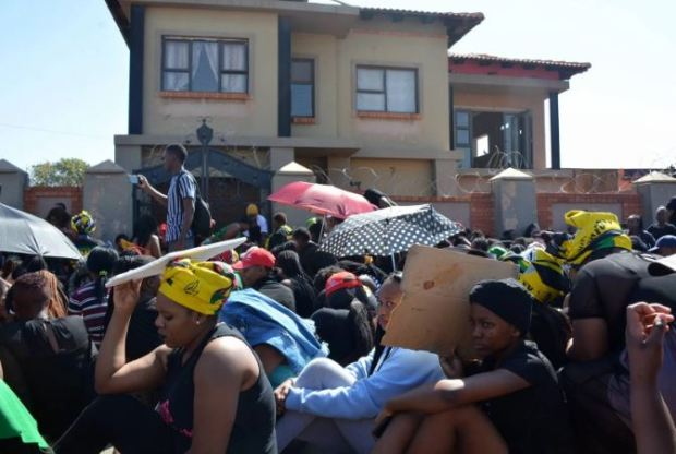 Female studentsat Tshwane University of Technology's Soshanguve campus, demand protection from landlord of Rape Den 1.JPG