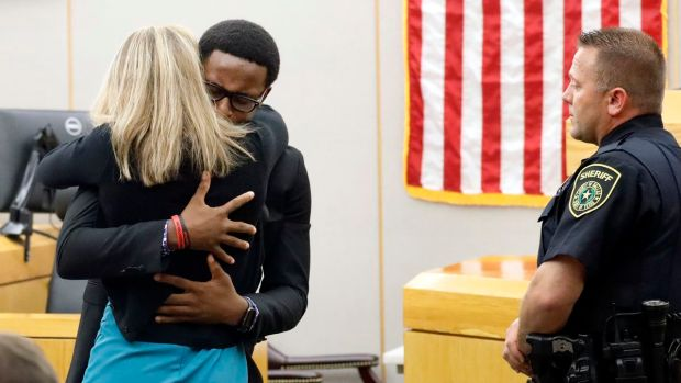 BothamJean's younger brother, Brandt, shared a lengthy courtroom embrace with his brother's killer after the sentencing.jpg