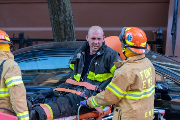EMTs evacuate injured fireman from homicide scene in Harlem, NY on Friday Oct 18 3.jpg