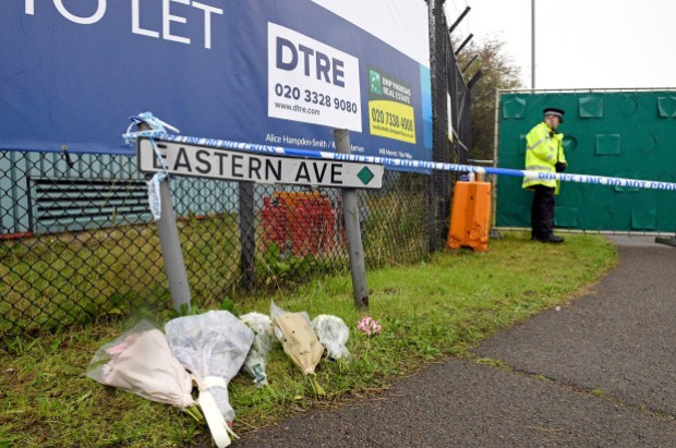 Flowers are left at the site where bodies of 39 chinese nationals were found inside a truck in the UK.jpg