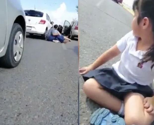 Panicked families flee their cars and lie flat on the road 1.JPG
