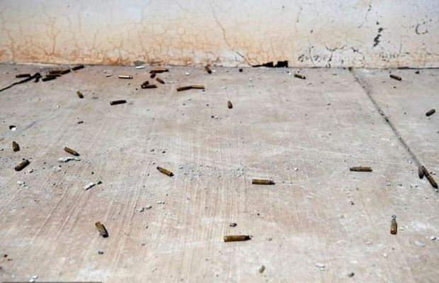 Dozens of bullet casings litter the sidewalk in Mexico 1.JPG