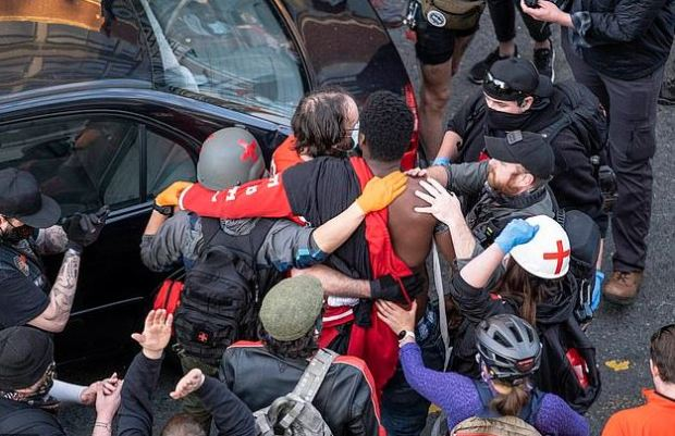 Victim is helped after driver plowed throughed BLM protesters in Seattle 1