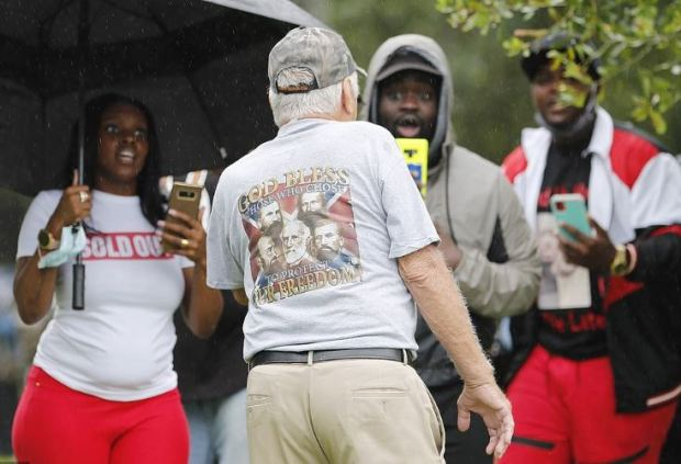 White man in confederacy short walks past Justice 4 Ahmuad Arbery protesters 2