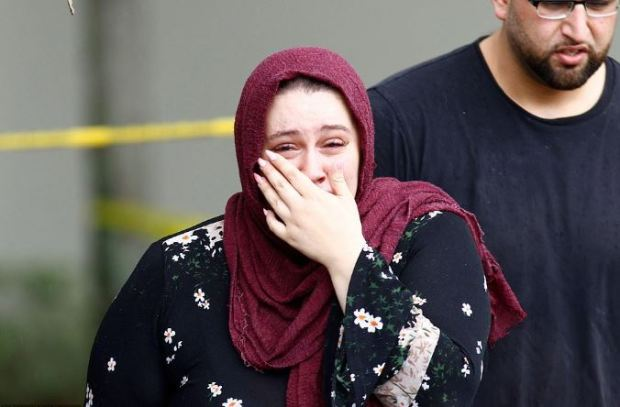 Woman weeps after Heba Momtaz Al-Azhari,was killed after she attacked a cop with knife 1
