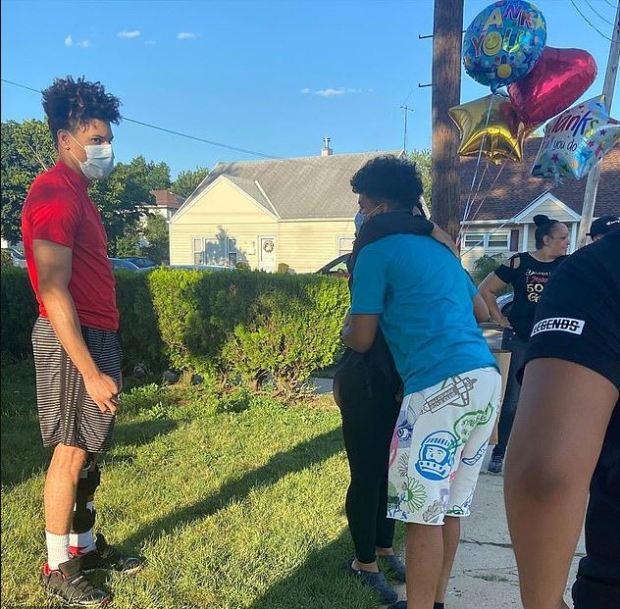 Jennifer McLeggan receives support from other neighbors 1