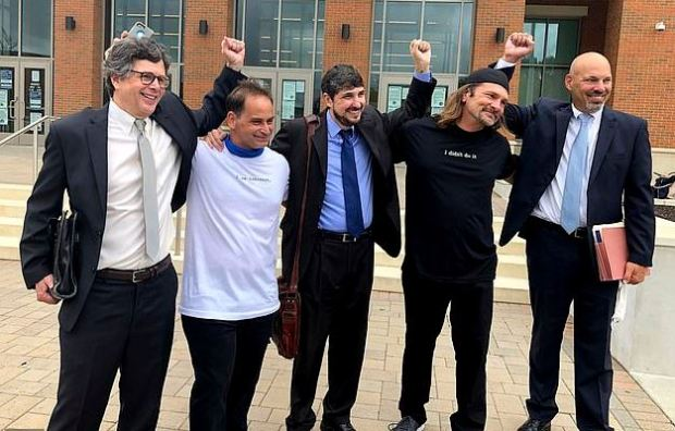Ricky Birch [second left] and Shawn Henning [second right] celebrate with their attorneys 2