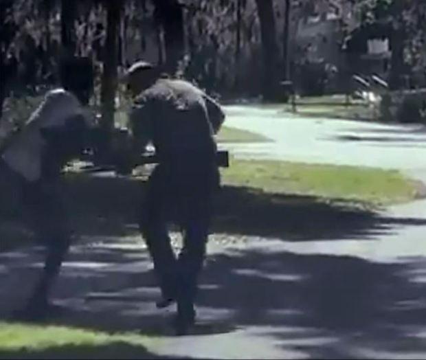 Travis McMichael [right] shoots Ahmaud Arbery [left] 1