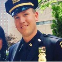 NYPD cop indicted after shooting wife's personal trainer when he found them alone outside home in the middle of the night' - Sgt. Justin Ellis faces 7 years, the trainer faces 4 years in prison if either is convicted for assault
