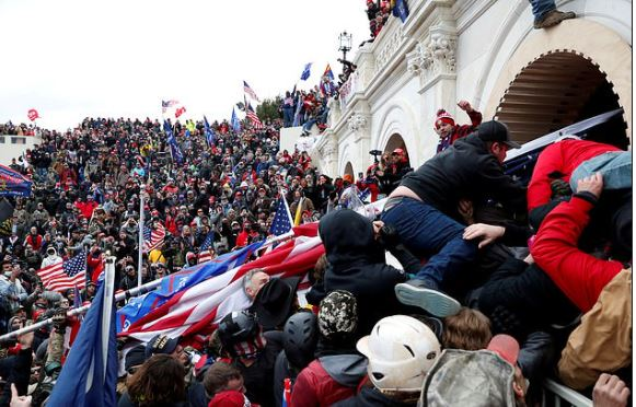 This image has an empty alt attribute; its file name is Mob-breaching-Capitol-during-Maga-riots-in-Washington-DC-on-Jan-7-2.jpg