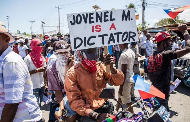 This image has an empty alt attribute; its file name is Haitians-protest-against-the-draft-constitutional-referendum-carried-by-the-President-Jovenel-Moise-1.jpg