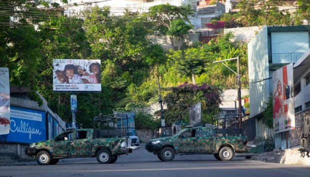 This image has an empty alt attribute; its file name is Military-vehicles-block-the-entrance-to-Petion-Ville-President-Jovenel-Moises-neighborhood-in-Port-au-Prince-Haiti-2.jpg