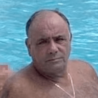 Fugitive Colombo mob consigliere surrenders to FBI in NYC, two days after his son posted and deleted picture of reputed mobster 'cooling off' poolside, in Florida