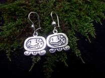 """Maya Nawal Glyph """" E """" Earrings $45.00 Amount Available: 1 On the upper right side are the ears which signify the path; the curves and the points are the stones placed on the side of the path and the steps on a stairway. E symbolizes the path of destiny, which means more of the path than you are able to see with your eyes; because it is the path of life, the guide, the one that takes us to a precise objective point."""
