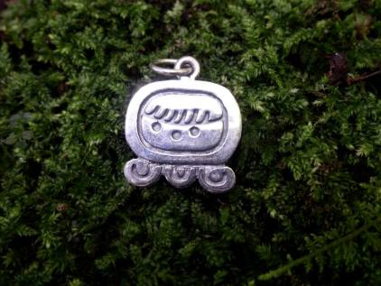 """Maya Nawal Glyph """" Ix """" Pendant $30.00 Amount Available: 1 The glyph signifies the heart of the planet, female reproduction, the face of a jaguar, the print of a jaguar, and the points of a map of the world. Ix signifies the jaguar and the tiger, female and feline energy. It represents the Mayan altar, the intelligence of mother earth; the seven guacamayas; a high level of developed consciousness; spirit protector of the planes and the mountains. Ix signifies the creative forces of the universe."""