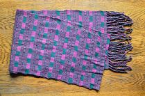 "7. $30.00 Measure: 10"" x 63"" (plus fringe) Very Soft. Hand washable. Amount available: 1 unit From San Juan la Laguna, Sololá. Woven by Tz'utujil-Maya women, of Asociación Comunitaria Ixoq Ajkeem. Products are made with natural dyes with the women themselves staining the raw threads with colors extracted from carrots, allspice, fuchsia, annatto seed, avocado leaves, sacatinta, hilamo, guachipilin, and St. John's Wort among others."
